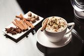 Espresso macchiato with spices — Stock Photo
