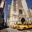 Stock Photo: Yellow taxis rides on 5th Avenue