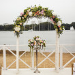 Wedding floral arch on the beach — Stock Photo