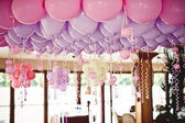 Balloons under the ceiling on the wedding party — Stok fotoğraf