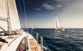 Sailing ship yachts with white sails — Stock Photo