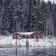 Stock Photo: Wooden cottage by river in Central Finland