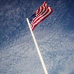 American flag over blue sky — Stock Photo #39667951