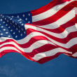 American flag over blue sky — Stock Photo