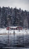 Wooden cottage by the river in Central Finland — Stock Photo