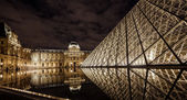 Louvre at night — Stock Photo