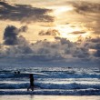 Surfer on Bali coastline — Stock Photo #44507393