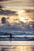 Surfer on Bali coastline — Stock Photo