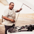 Native American man repairing car — Stock Photo