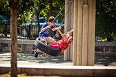 Children having fun on a swing — Stock Photo