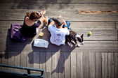 Man and woman with dog on pier — Stock Photo
