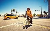 Man riding bike — Stock Photo
