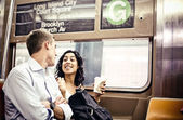 Couple in in subway wagon — Stockfoto
