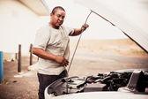Native American man repairing car — Stock Photo