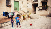 Children with a ball in Matera — Stock Photo