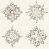 Set of four mandalas. Beautiful hand drawn flowers. — Stock Vector