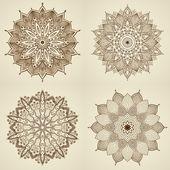 Set of four mandalas. Beautiful flowers. — Stock Vector