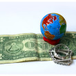 Globe and one dollar - Stock Photo