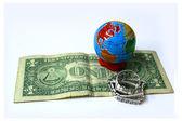 Globe and one dollar — Stock Photo
