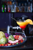 Orange cocktail with a straw — Stock Photo