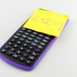 Calculator and sticky note — Stock Photo #40249599