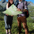 Hikers in the mountains — Stock Photo