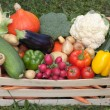 Fresh vegetables in a wooden box - Stock Photo