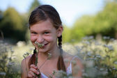 Young girl holding a flower — Stock Photo