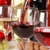 Red wine pouring into a wine glass — Stock Photo
