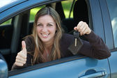 Happy driver with car key — Stock Photo