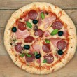 Stock Photo: Pizza with ham and pepperoni