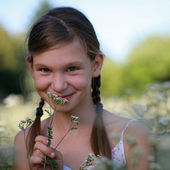 Young girl on a flower meadow — Stock Photo