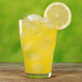 Cold orange lemonade in a glass — Stock Photo