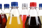 Different bottles with soda — Stock Photo