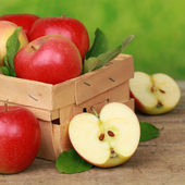 Freshly picked apples in a wooden box — Stock Photo