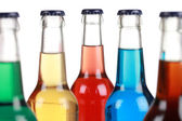 Glass bottles with soft drinks — Stock Photo