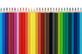Colored pencils in a row, isolated — Stock Photo