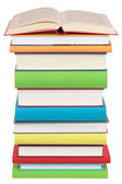 Opened book on a stack of books — Stock Photo