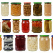 Collection of vegetables in glass jars — Stock Photo
