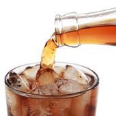 Cola pouring into a glass, isolated — Stock Photo