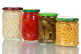 Preserved vegetables in glass jars — Stock Photo