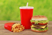 Cheeseburger combo meal with french fries and cola — Stock Photo