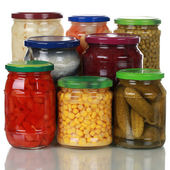 Preserved vegetables in glass jars — Stock Photo