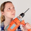 Young woman with drilling machine — Stock Photo