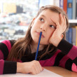 Schoolchild thinking while doing homework — Photo