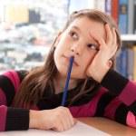 Schoolchild thinking while doing homework — Stock Photo