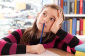 Schoolchild thinking while doing homework — Stock Photo