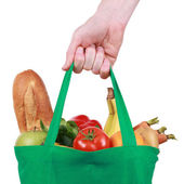 Reusable shopping bag filled with fruits and vegetables — Stock Photo