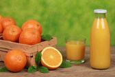 Oranges and fresh juice — Stock Photo