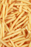 Background from fresh French fries — Stock Photo